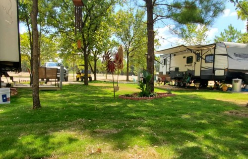 Large RV Space with new RV's under trees